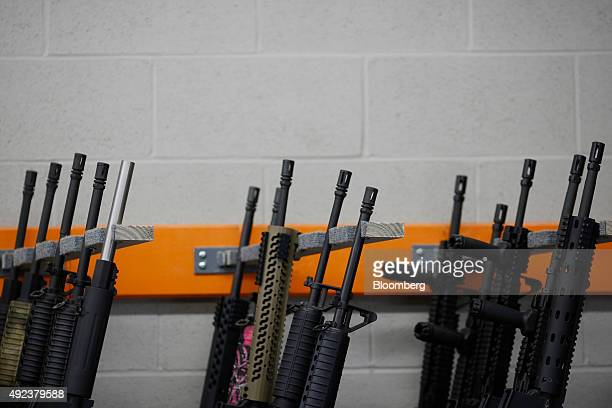 Civilian legal AR15 rifles are displayed for sale at a vendor's booth during the Fall 2015 Knob Creek Machine Gun Shoot in West Point Kentucky US on...