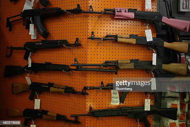 Civilian legal Kalashnikov variants are displayed for sale at a vendor's booth during the Fall 2015 Knob Creek Machine Gun Shoot in West Point...