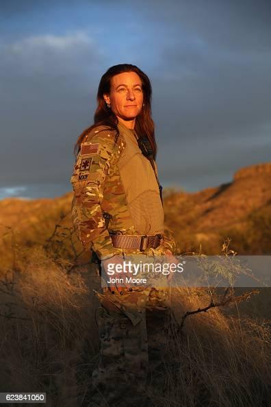 Civilian paramilitary Kat Nooy stands in the Arizona Border Recon camp near the USMexico border on November 16 2016 in Pima County Arizona Nooy works...
