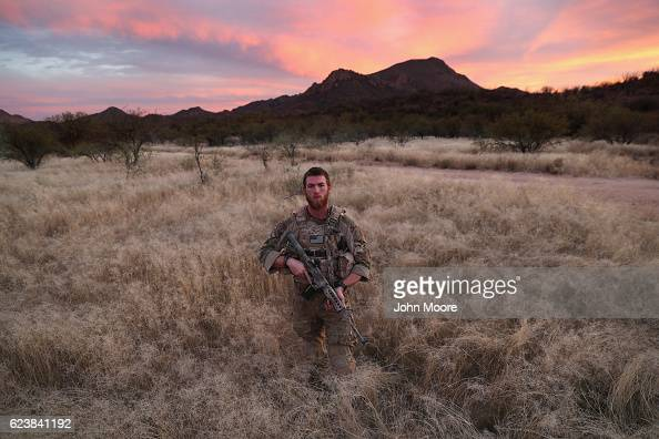 Civilian paramilitary volunteer James for Arizona Border Recon stands near the USMexico border on November 16 2016 in Pima County Arizona The college...