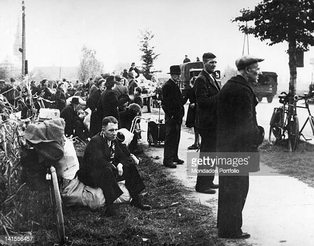 Civilian refugees of the Dutch city of Nijmegen waiting for the trucks that will transport them behind the lines of the front Netherlands November...