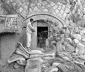 Korean civilian shows U. S. Marine dynamite cache near Inchon, South Korea.
