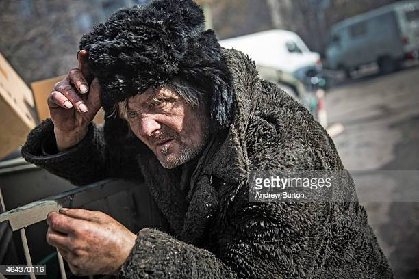 A civilian smokes a cigarette on February 25 2015 in Debaltseve Ukraine After approximately one month of fighting Russian backed rebels successfully...