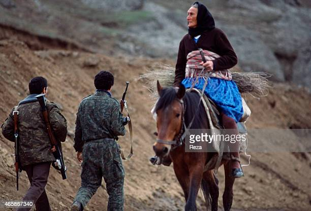 A civilian woman riding a horse passes Azerbaijani soldiers patrolling a mountain road in March 1992 in Karabakh Azerbaijan In early 1988 the...