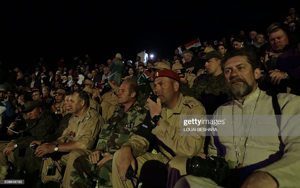 Civilians and military personnel attend a music concert in the ancient theatre of Syria's ravaged Palmyra on May 6, 2016 following its recapture by regime forces from the Islamic State group fighter. Syrian troops backed by Russian air strikes and special forces on the ground recaptured UNESCO world heritage site Palmyra from Islamic State (IS) group fighters in March 2016. BESHARA