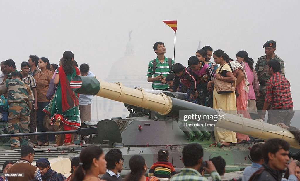 Civilians climbed on T20 tank during 'Army Equipment Display and Military Tattoo' at Army Polo Ground, Race Course on February 2, 2013 in Kolkata, India.
