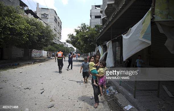 Civilians flee from Gaza's eastern Shejaiya district on July 20 2014 At least 40 people were killed and nearly 400 wounded in Israeli shelling of...