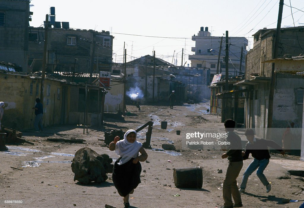 Civilians flee gunfire from armed soldiers in the streets of Gaza. Violence broke out after rebel Israeli and Palestinian fighters protested in the occupied territory of Gaza during the first Intifada.