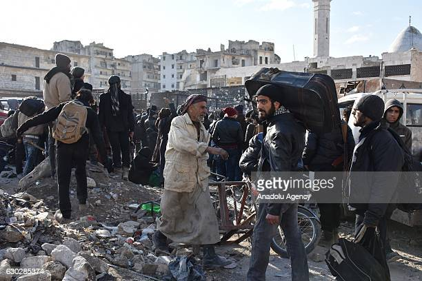 Civilians from East Aleppo which was under siege by Assad regime forces and its supporter foreign terrorist groups wait for their evacuation at...