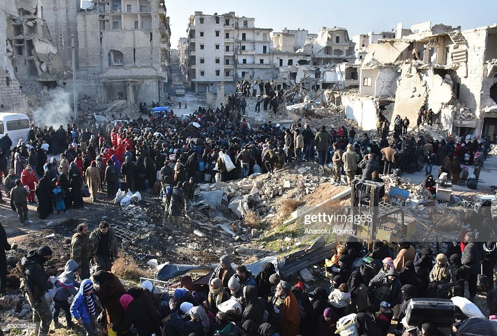 Civilians from East Aleppo, which was under siege by Assad regime forces and its supporter foreign terrorist groups, wait for their evacuation at Amerriye region of Aleppo, Syria on December 20, 2016.