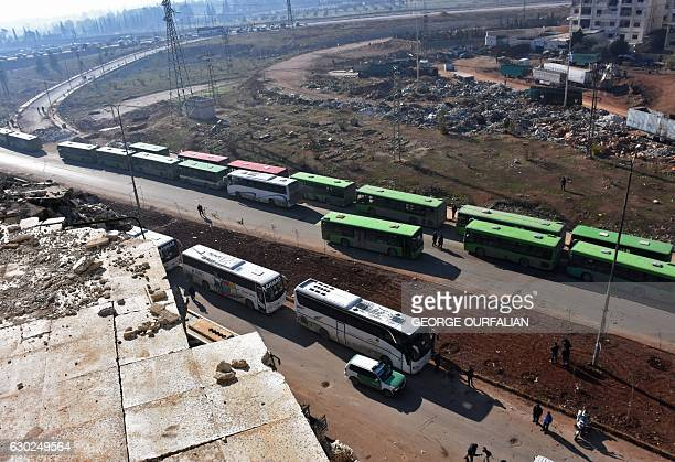 TOPSHOT Civilians from the remaining rebelheld pockets of eastern Aleppo are evacuated from the embattled city by bus on December 19 2016 The...