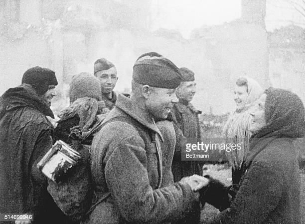 Civilians Greet Red Soldiers as Liberators of Kiev USSRRussian veterans stormed into Kiev which had been left afire by the withdrawing Germans Stalin...