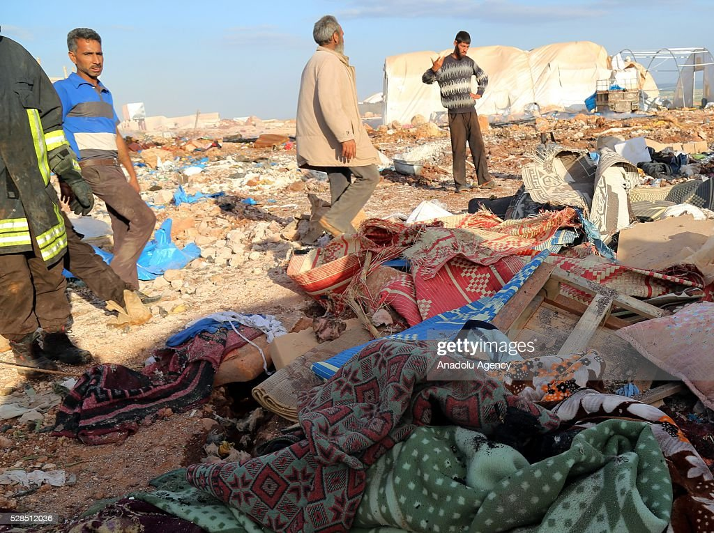 Civilians inspect the damage after a Syrian regime warplane targeted the Kamuna refugee camp near the Sarmada town of Idlib province, Syria on May 05, 2016. Eight people were killed and another 30 injured when a regime warcraft targeted the Kamuna refugee camp.