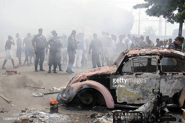 Civilians protested after authorities entered the Mangueira district The riots and violence resulted in several burnt cars and in the death of a drug...