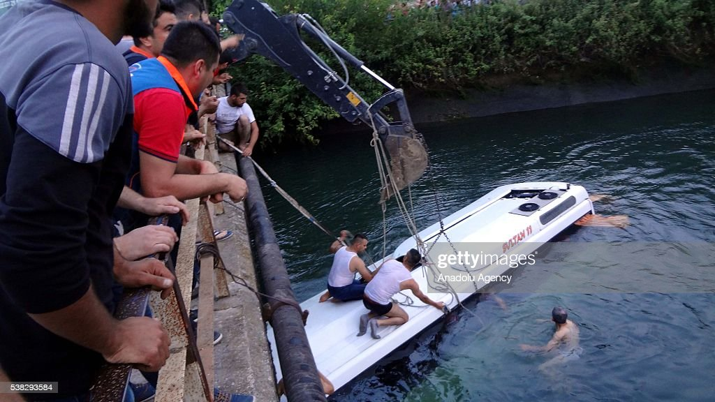 Civilians try to rescue people from a bus carrying primary school students teachers and parents toppling over irrigation channel in Osmaniye Turkey...