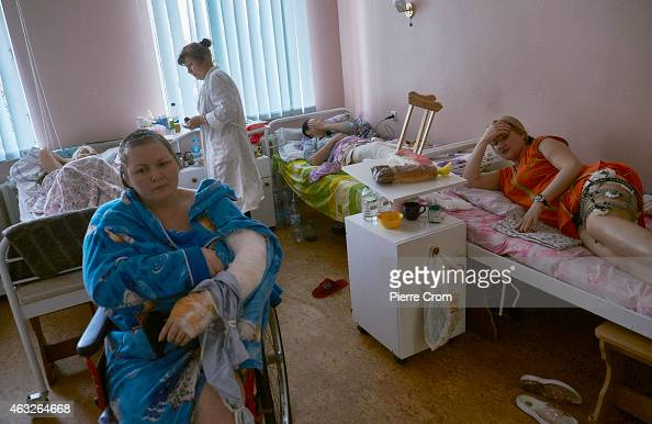 Civilians wounded during artillery shelling recover in a hospital on February 12 2015 in Donetsk Ukraine The leaders of Russia Ukraine Germany and...