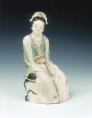 Cizhou figure of a seated lady with polychrome overglaze enamels Jinearly Yuan dynasty China 13th century A graceful lady seated on the edge of a...