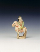 Cizhou figure of a woman on a horse Jin/Yuan dynasty Hebei province China 13th century Small Cizhou moulded stoneware figure decorated with...