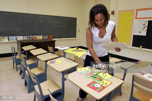 Ckaris Williams a teacher and Hurricane Katrina evacuee prepares her classroom at Douglass Elementary School in Houston September 7 2005 in Houston...