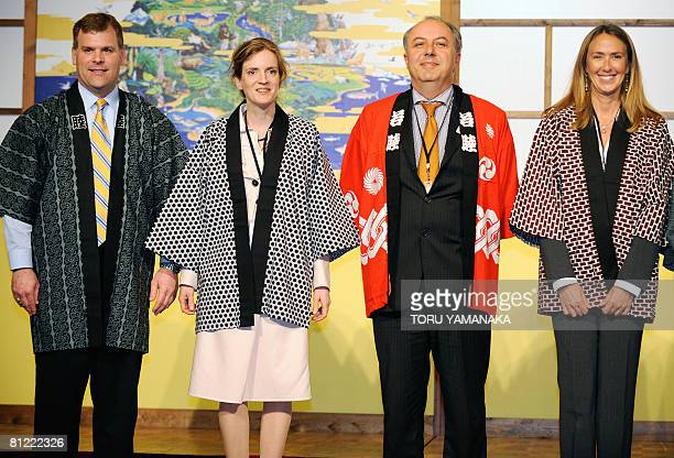 Clad in Japanese traditional 'happi' coats Canadian Environment Minister John Baird French State Secretary for Ecology Nathalie KosciuskoMorizet...