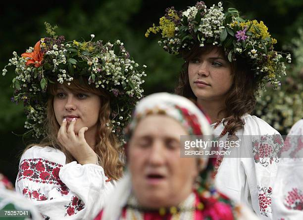 Clad in Ukrainian traditional outfit Ukrainian girls listen to a song at Pirogovo village near Kiev during a celebration of Ivana Kupala Night an...