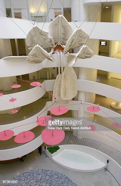 Claes Oldenburg's 'Soft Shuttlecock' hangs supended over a mobile featuring pink disks at the Global Guggenheim exhibit in the Guggenheim Museum