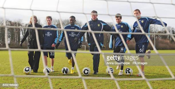 Clair Chadwick of Yorkshire Cancer Research with Leeds United's Aidy White Max Gradel Simon Grayson Jonny Howson and Richard Naylor during the launch...