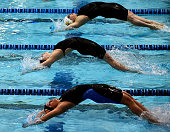 Claire Adams performs a backstroke start during the preliminary heats of the women's 100m backstroke during the 2016 Arena Pro Swim Series at...