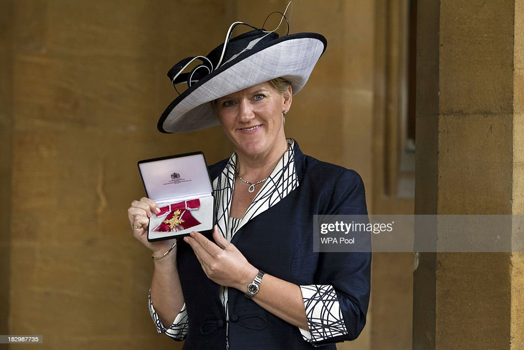 Claire Balding receives an OBE for services to Brodcasting and Journalism at Windsor Castle on October 3, 2013 in Widsor, England.