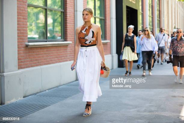 Claire Beermann outside the Fendi show during Milan Men's Fashion Week Spring/Summer 2018 on June 19 2017 in Milan Italy