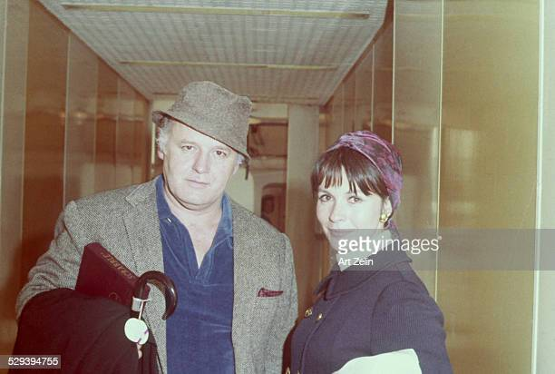 Claire Bloom with her husband Rod Steiger in a hall way They are dressed to go out and have a Scrabble game circa 1970 New York