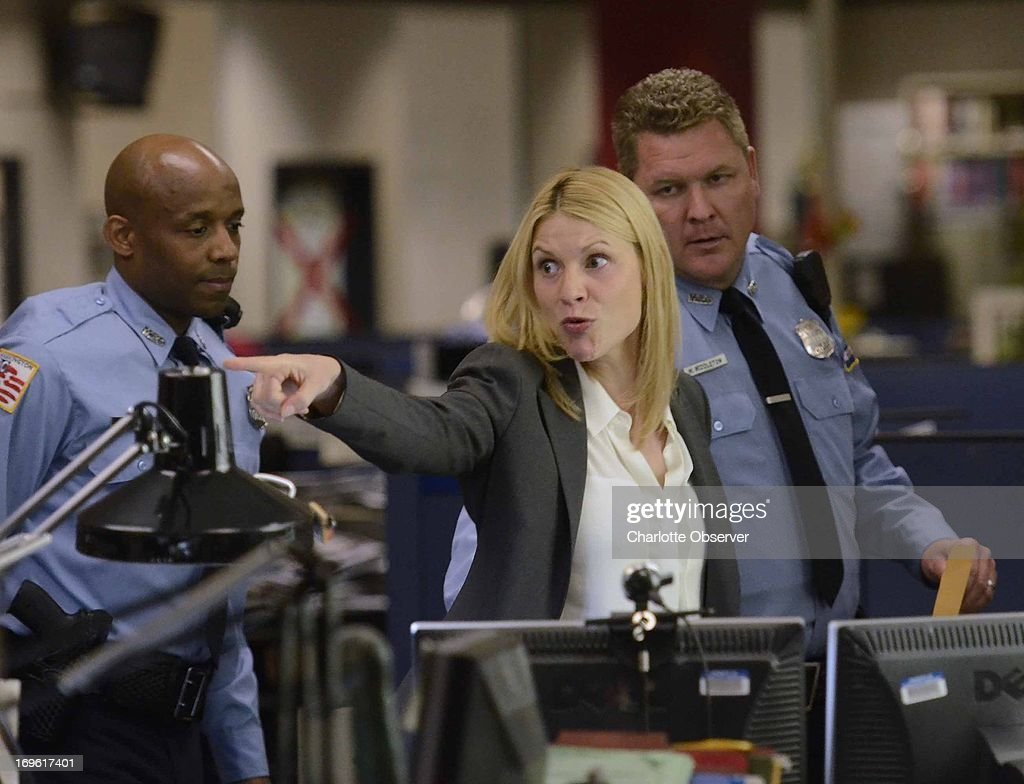 Claire Danes acts in a scene as Showtime brings the production of 'Homeland' to the newsroom floor of the Charlotte Observer May 28 2013 in Charlotte...