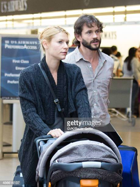 Claire Danes and Hugh Dancy are seen at Los Angeles International Airport with their son Cyrus Dancy on July 30 2013 in Los Angeles California