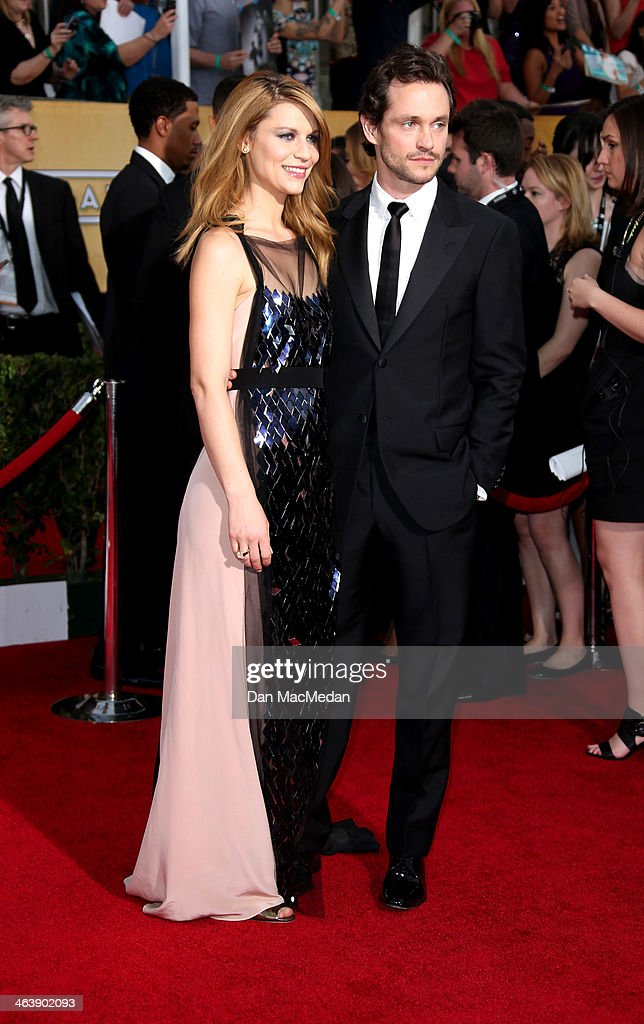 Claire Danes and Hugh Dancy arrive at the 20th Annual Screen Actors Guild Awards at the Shrine Auditorium on January 18, 2014 in Los Angeles, California.