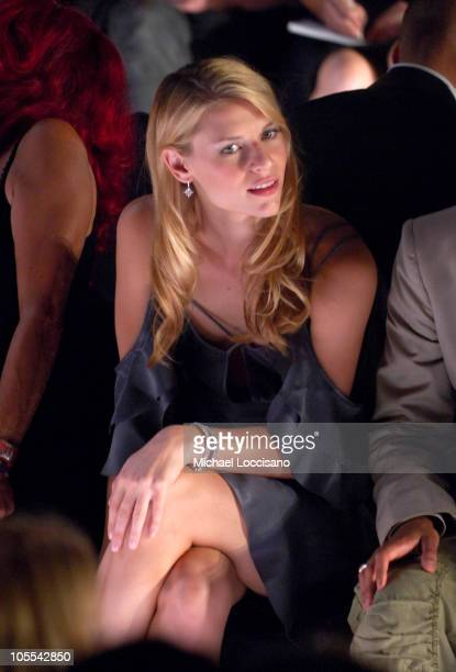 Claire Danes during Olympus Fashion Week Spring 2006 Zac Posen Front Row Runway and Backstage at Bryant Park in New York City New York United States