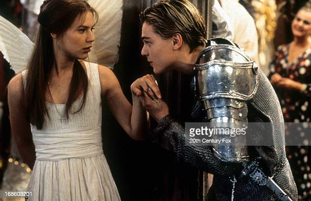 Claire Danes is surprised as Leonardo DiCaprio takes her hand to kiss in scene from the film 'Romeo Juliet' 1996