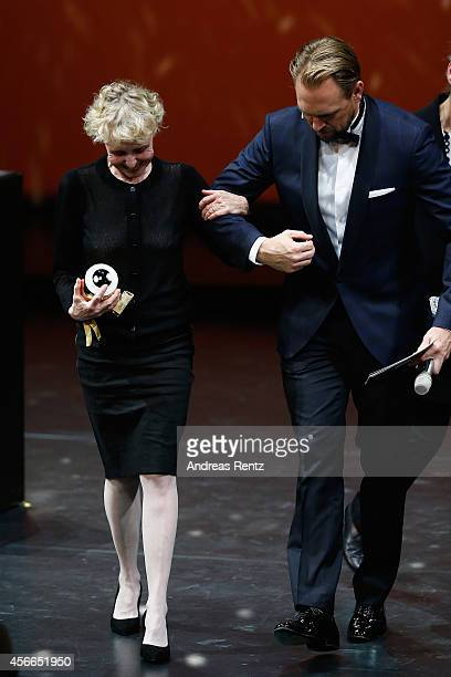 Claire Denis and Steven Gaetjen seen on stage at the Award Night Ceremony during Day 10 of Zurich Film Festival 2014 on October 4 2014 in Zurich...