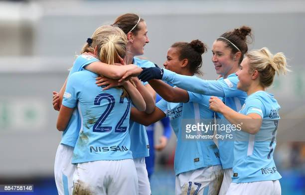 Claire Emsley of Manchester City Women celebrates scoring her sides second goal with team mates during the FA WSL Continental Tyres Cup between...