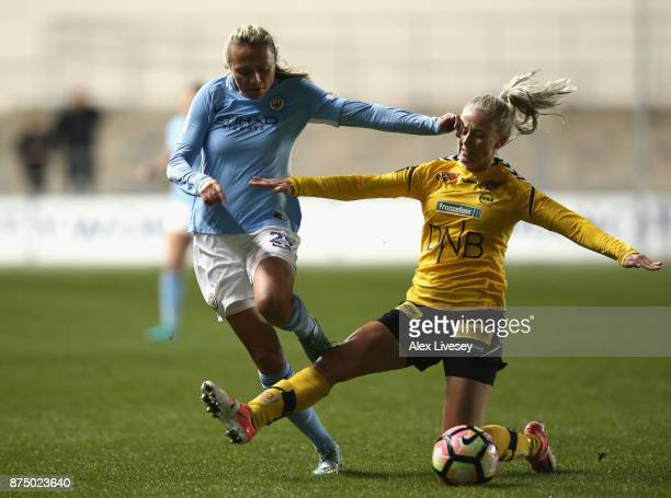 Claire Emslie of Manchester City Women beats Aja Sonstevold of LSK Kvinner during the UEFA Women's Champions League match between Manchester City...