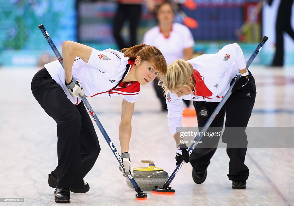Claire Hamilton and <a gi-track='captionPersonalityLinkClicked' href=/galleries/search?phrase=Anna+Sloan&family=editorial&specificpeople=7577274 ng-click='$event.stopPropagation()'>Anna Sloan</a> of Great Britain compete during the Curling Women's Round Robin match between Russia and Great Britain on day ten of the Sochi 2014 Winter Olympics at Ice Cube Curling Center on February 17, 2014 in Sochi, Russia.