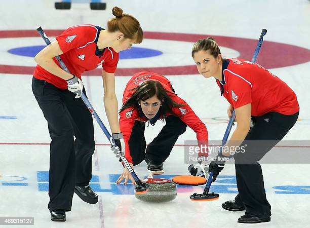 Claire Hamilton and Vicki Adams of Great Britain sweep the ice as Eve Muirhead delivers the stone during the Curling Women's Round Robin match...