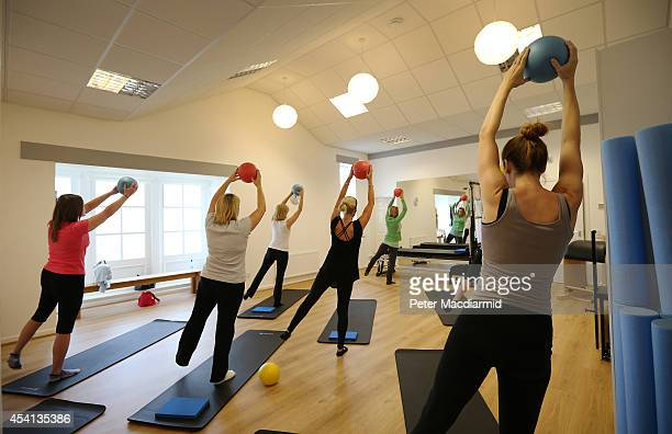 Claire Heslop takes a class at the Central Pilates Studio housed in a former chapel on August 7 2013 in Colombia England The name Columbia was given...
