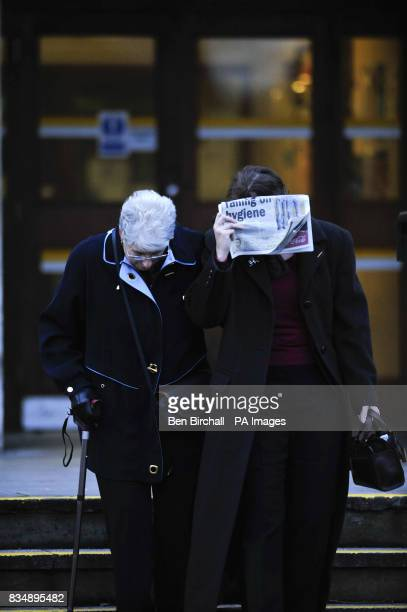 Claire Jones tries to hide her face with a newspaper as she leaves Cardiff Central Police Station with her mother Jill Jones where an inquest into...