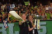 Claire Koski and Alex Blackwell of the Thunder take a selfie with the tropy following the Big Bash League final match between Melbourne Stars and the...