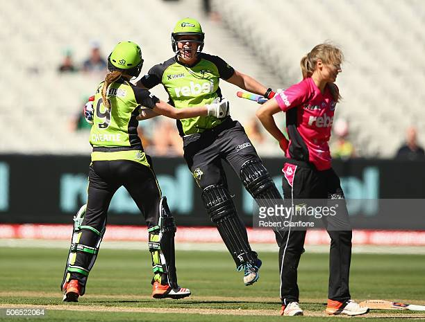 Claire Koski and Lauren Cheatle of the Thunder celebrate after the Thunder defeated the Sixers during the Women's Big Bash League Final match between...