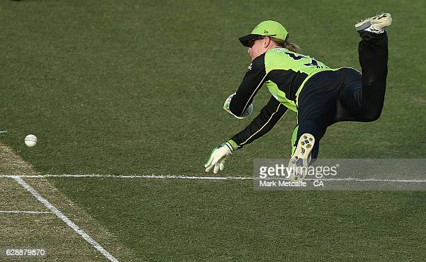 Claire Koski of the Thunder attempts a diving runout during the Women's Big Bash League match between the Sydney Thunder and the Melbourne Stars at...
