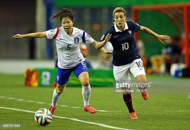 Claire Lavogez of France and Lee Subin of Korea Republic battle for the ball during the FIFA U20 Women's World Cup 2014 quater final match between...
