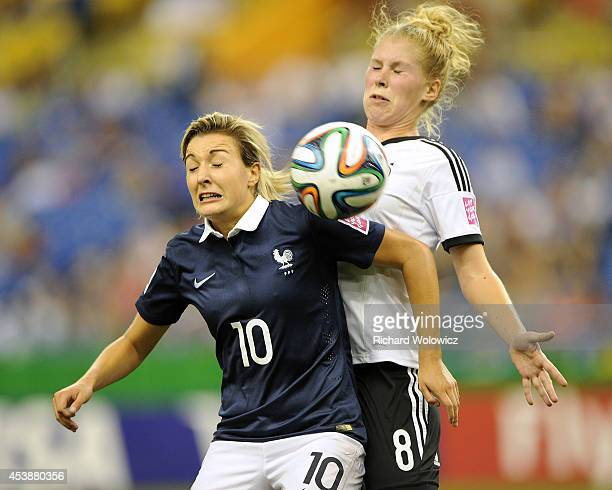 Claire Lavogez of France and Rebecca Knaak of Germany battle for the ball during the FIFA Women's U20 Semi Final game at Olympic Stadium on August 20...