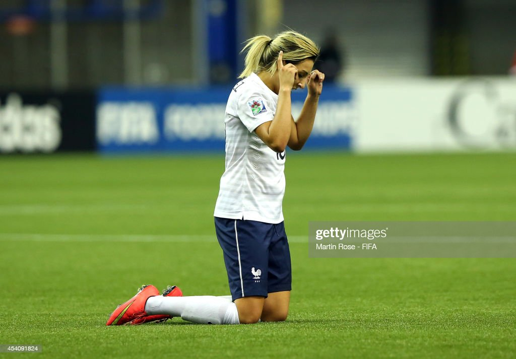 Claire Lavogez of France celebrates after winning the FIFA U-20 Women's World Cup 2014 3rd place playoff match between Korea DPR and France at Olympic Stadium on August 24, 2014 in Montreal, Canada.