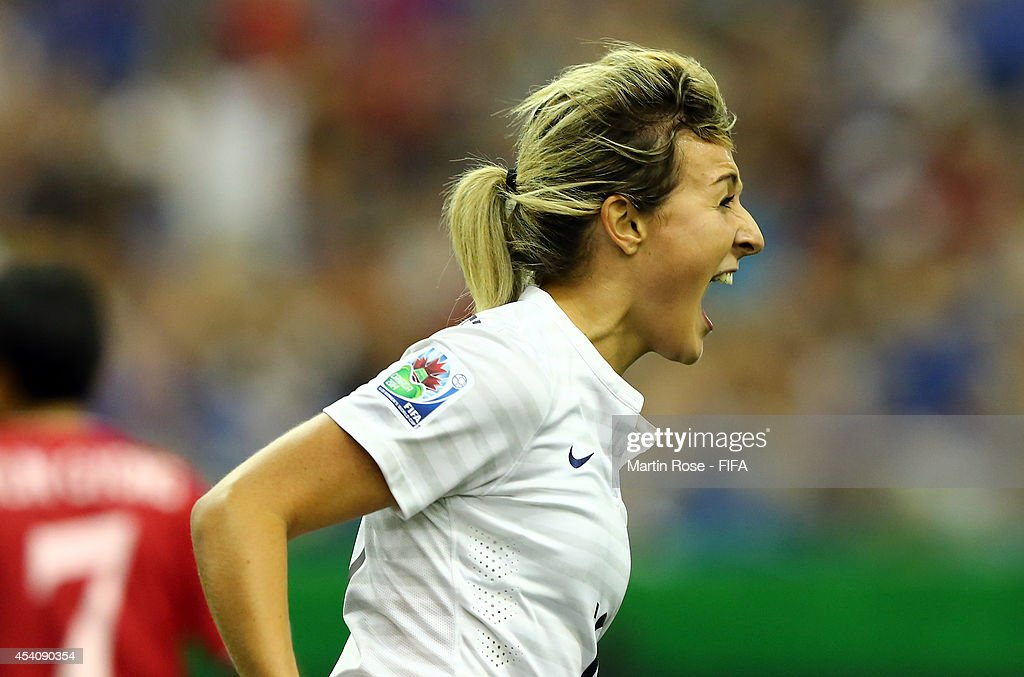 Claire Lavogez of France celebrates their equalizing goal during the FIFA U-20 Women's World Cup 2014 3rd place playoff match between Korea DPR and France at Olympic Stadium on August 24, 2014 in Montreal, Canada.